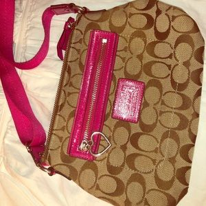 Coach crossbody bag with pink details!